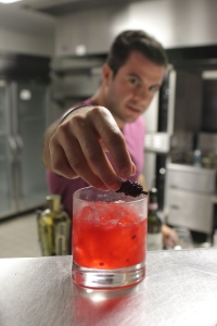 La Cosecha's mixologist, Eric Carfagnini, puts the finishing touches on a signature cocktail.
