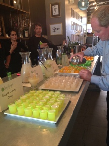 Pouring shot-sized samples of sake and sherry cocktails for the kick-off party