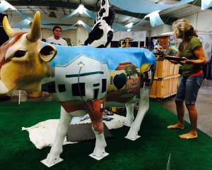 Carol Paulsen worked diligently on painting the Town of Harmony on her Cow - the detail is incredible!